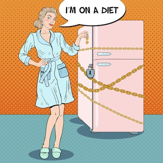 Pop art young woman on diet with locked fridge