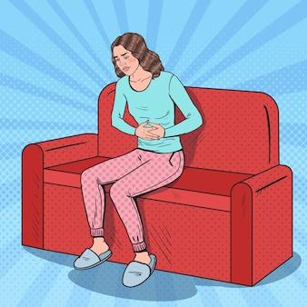 Pop art young woman suffering stomach ache