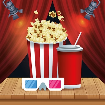 Pop corn bucket with soda cup and 3d glasses over red theater curtains