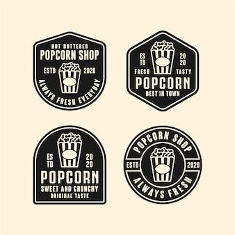 Изолированная иллюстрация логотипа дизайна магазина попкорна