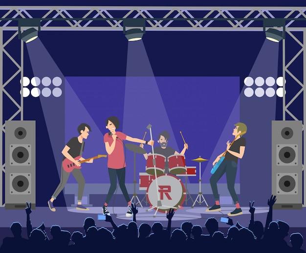 Популярные рок-звезды выступают на сцене