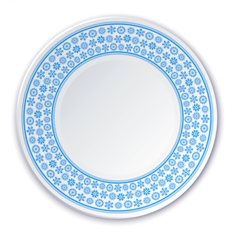 Porcelain plate on a painting of a blue snowflakes on a white background