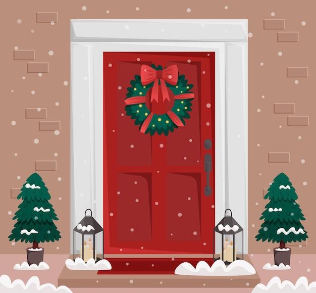 花輪の雪とモミとクリスマスの赤いドアとポーチ