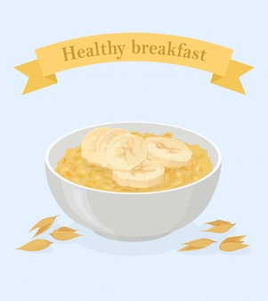 Porridge oats in bowl with bananas and cereals