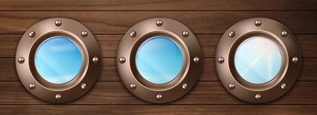 空の景色と木製の壁に船のport窓