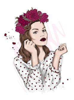 Portrait of a beautiful girl in a flower wreath