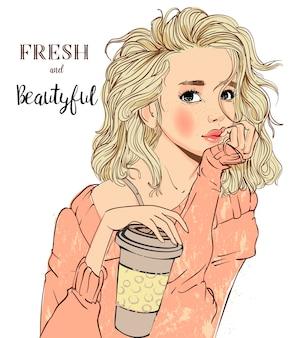 彼女の手にコーヒーカップを持つ若い女性の肖像画