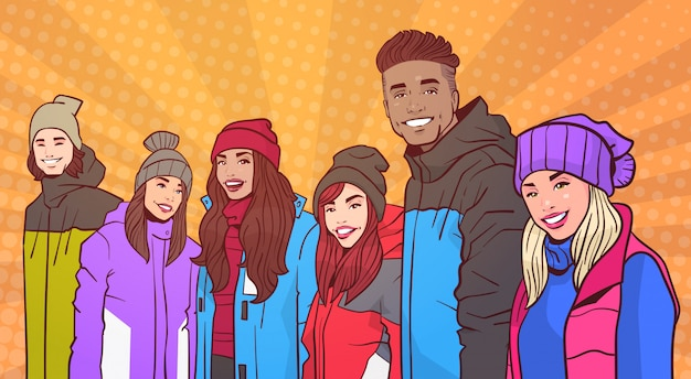 Portrait of smiling group of people wear winter clothes over colorful retro style background mix race young adults