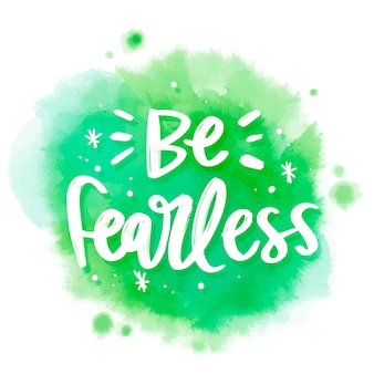 Positive lettering be fearless message on watercolor stain