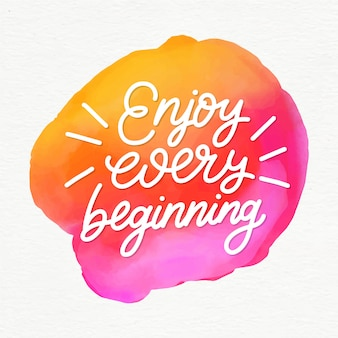 Positive lettering enjoy every beginning message on watercolor stain
