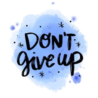 Positive lettering don't give up message on watercolor stain