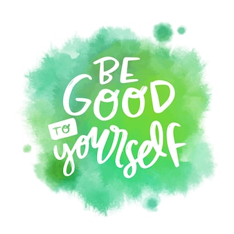 Positive lettering message on green watercolor stain