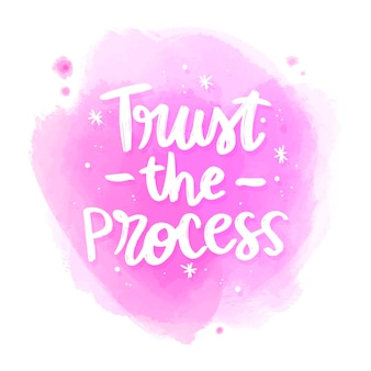 Positive lettering trust the process message on watercolor stain