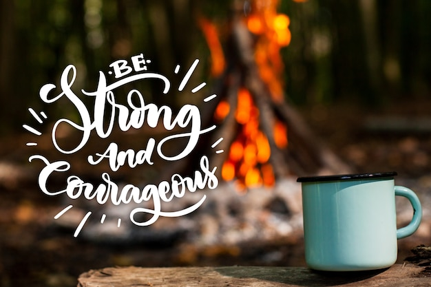 Positive lettering with photo of campfire and mug