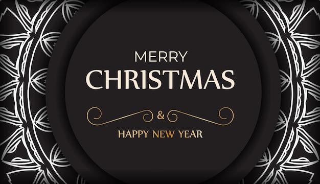 はがき明けましておめでとうとメリークリスマス、白の飾りが付いた黒。
