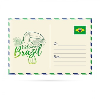 Postcard invitation with a picture toucan. card welcome to brazil. stamp with the national flag of brazil. invitation welcome to brazil.