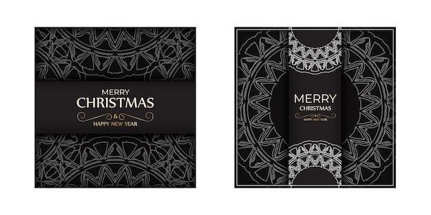 白い装飾が施された黒のポスターメリークリスマスと新年あけましておめでとうございます。