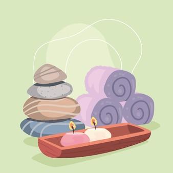 石のキャンドルとタオルでスパのポスター