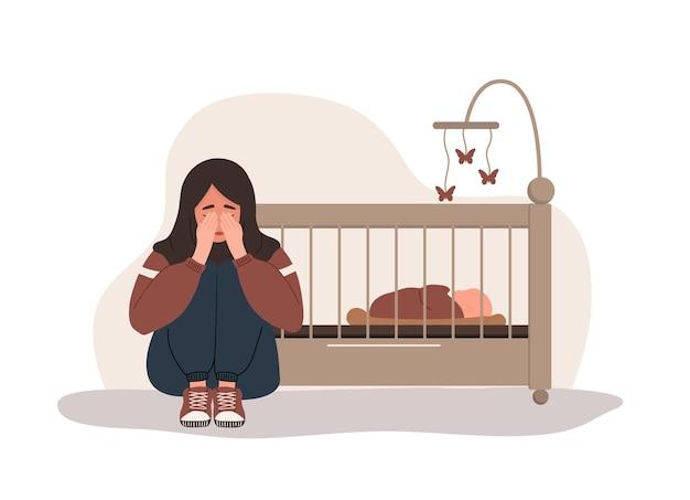 産後うつ病。アラブの疲れた女性が泣いて膝を抱きしめています。