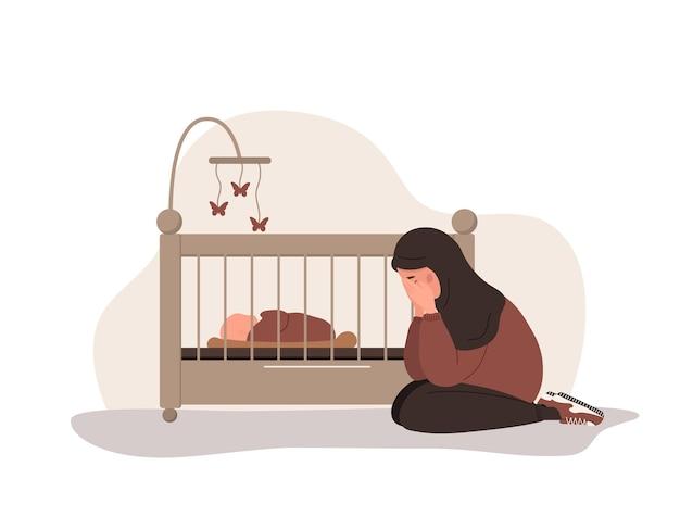 산후 우울증. 아랍 여자가 요람 근처에 앉아 있다. 어머니는 심리적 도움이 필요합니다.
