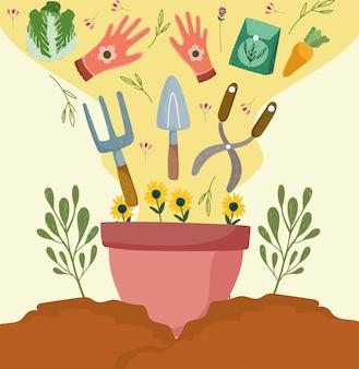 도구와 화분에 심은 꽃