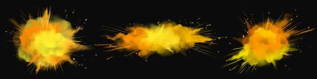 분말 holi는 주황색, 금색, 노란색 폭발 구름, 잉크 얼룩, 검정에 고립 된 축제를위한 장식용 생생한 염료를 페인트합니다.
