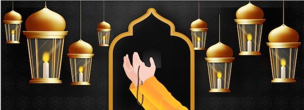 Praying human hands in front of mosque door and hanging illumina