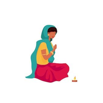祈るインドの女の子フラットカラーの顔のない文字