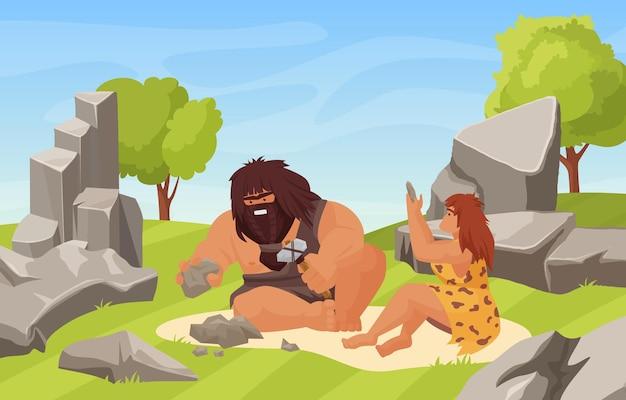 선사 시대 석기 시대와 원시 부부는 동굴 근처에서 돌을 부수기 위해 노력합니다.