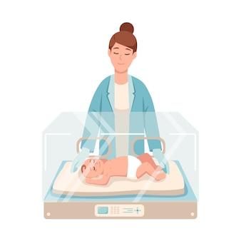 Premature newborn infant lies inside neonatal intensive care unit, female doctor or pediatric nurse stands beside it and checks
