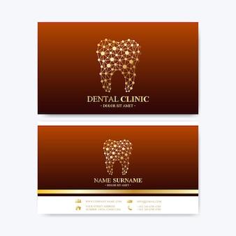 Премиум шаблон для печати визитной карточки. визитная карточка стоматологической клиники с логотипом зуба. уход за полостью рта в стоматологическом кабинете. зубные имплантаты. медицинский дизайн золотой зуб логотип.