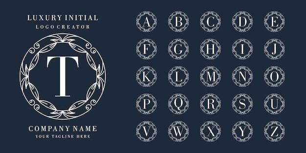 Premium initial logo design with floral frame