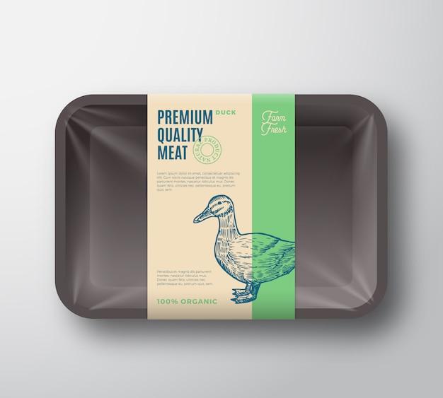 プレミアム品質のダックパック。セロハンカバー付き抽象家禽プラスチックトレイコンテナー。包装ラベル。現代のタイポグラフィと手描きのアヒルシルエット背景レイアウト。