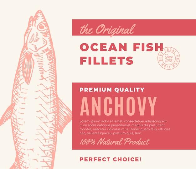 プレミアム品質の魚の切り身。抽象的な魚のパッケージデザインまたはラベル。現代のタイポグラフィと手描きのアンチョビシルエット背景レイアウト