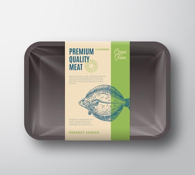 Камбала высшего качества. абстрактный пластиковый лоток для рыбы с этикеткой дизайна упаковки крышки целлофана. современная типография и рисованной камбалы силуэт фона макета.