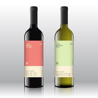 Этикетки для красных и белых вин высшего качества на реалистичных бутылках. чистый и современный минимализм со стильной минималистичной типографикой.