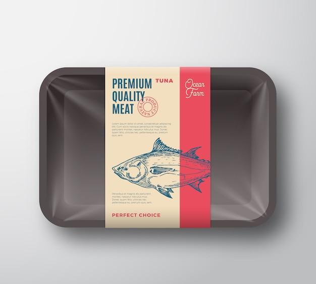 프리미엄 품질 참치 팩. 셀로판 커버와 함께 추상 벡터 물고기 플라스틱 트레이 컨테이너. 프리미엄 벡터