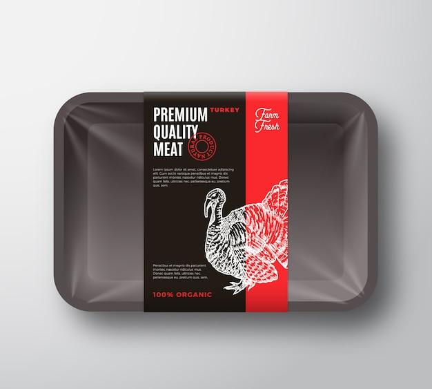 프리미엄 품질의 칠면조 고기 패키지 및 라벨 스트라이프. 셀로판 덮개가있는 식품 플라스틱 트레이 용기. 포장 레이아웃. 타이포그래피와 손으로 그린 터키 실루엣 배경입니다.
