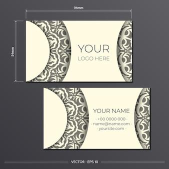 曼荼羅のデザインでゴージャスなベクトルパターンでライトクリームの名刺を準備します。モノグラム飾り付きプリントデザイン名刺のテンプレート。