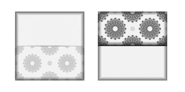 텍스트와 검은색 장식품을 위한 장소가 있는 초대장을 준비합니다. 인쇄 디자인 엽서 서식 파일 만다라와 흰색 색상입니다.