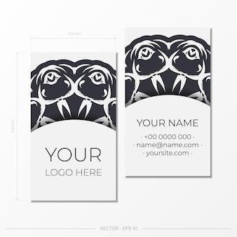 Готовим визитки белого цвета со старинным орнаментом. шаблон для полиграфического дизайна визитной карточки с узорами вензеля.