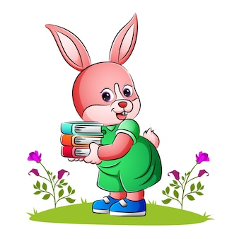 The pretty bunny is holding many book with the hand of illustration