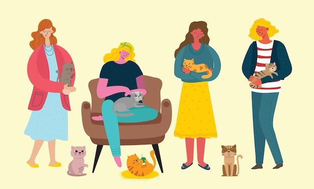 Симпатичные девушки держат симпатичного кота на коленях и кошек вокруг