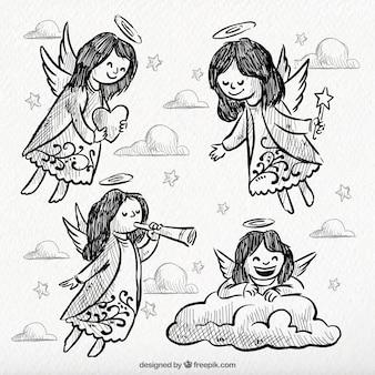 Pretty hand drawn angels Free Vector