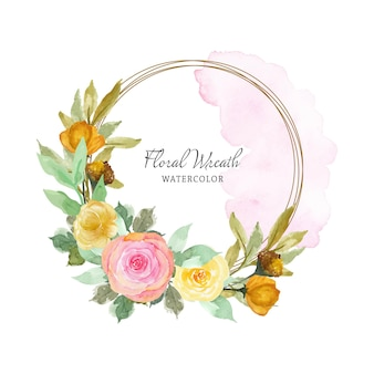 Pretty pink and yellow rustic floral wreath with abstract watercolor stain