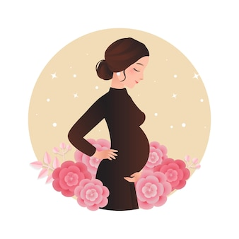 花で飾られた赤ちゃんのバンプでポーズをとってかなり妊娠中の女性