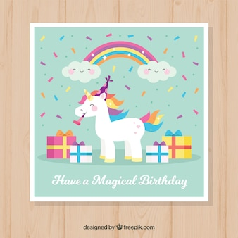 Pretty unicorn card with gifts Premium Vector