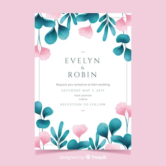 Pretty wedding invitation with watercolor leaves and flowers