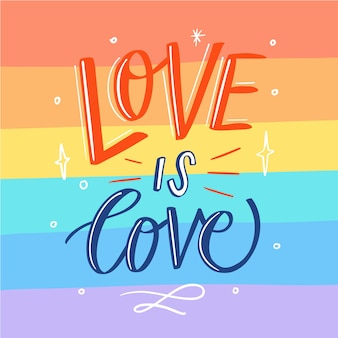 Pride day lettering on flag background