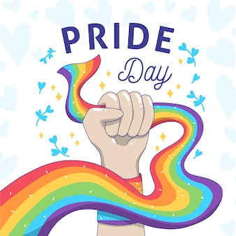 Pride day and strong fist holding the flag
